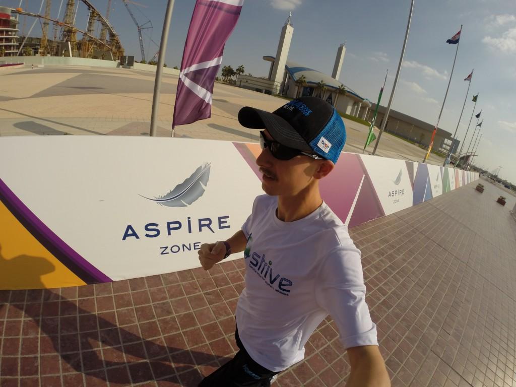 Running around the Aspire Zone - loving the sunshine and warmth, but not so much the hard brick!